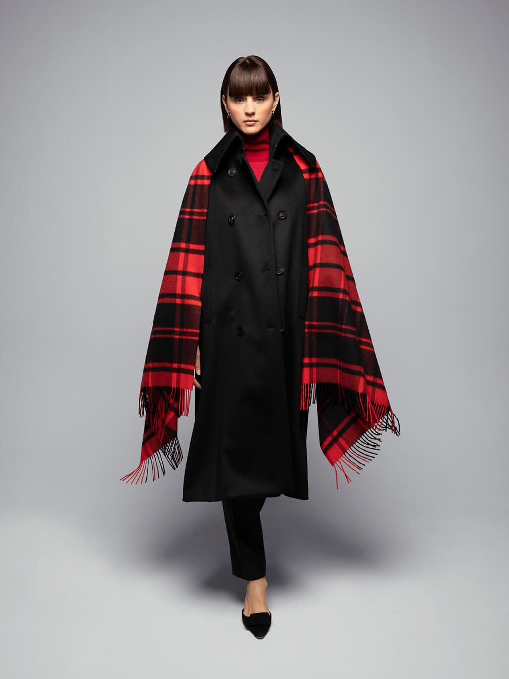 Johnstons of Elgin model wearing a Classic Tartan Cashmere Stole in Pictish Kingdom on a grey background
