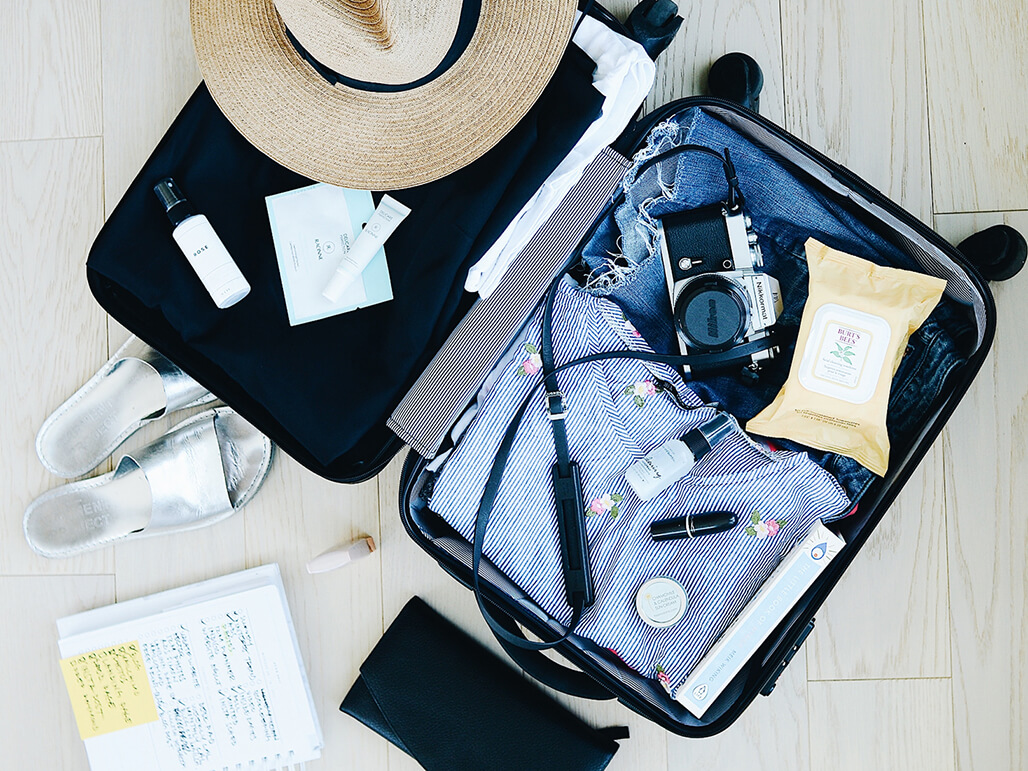 An open suitcase, suggestive of summer holidays
