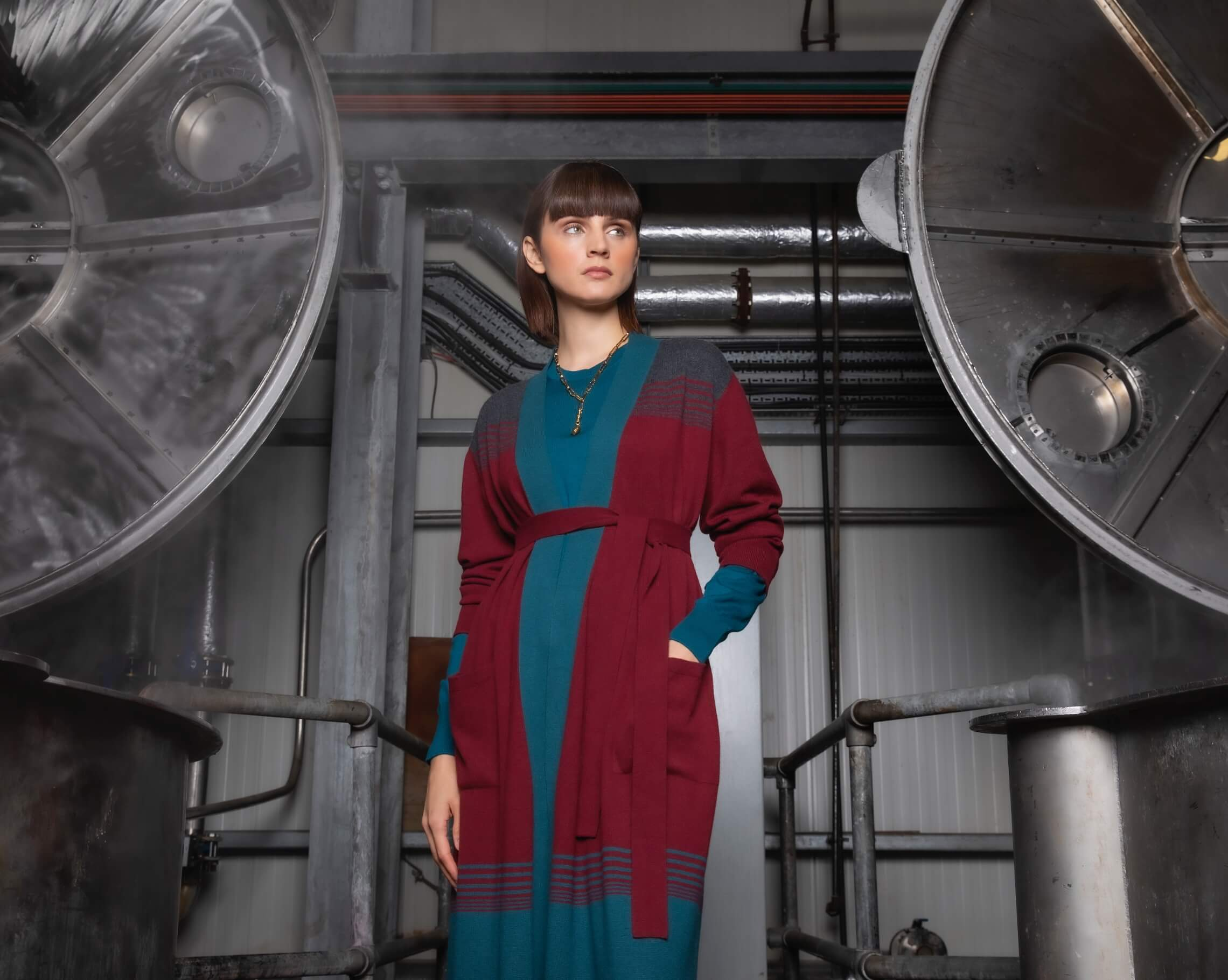 Johnstons of Elgin model wearing ombre clothing in the Johnstons of Elgin dyehouse