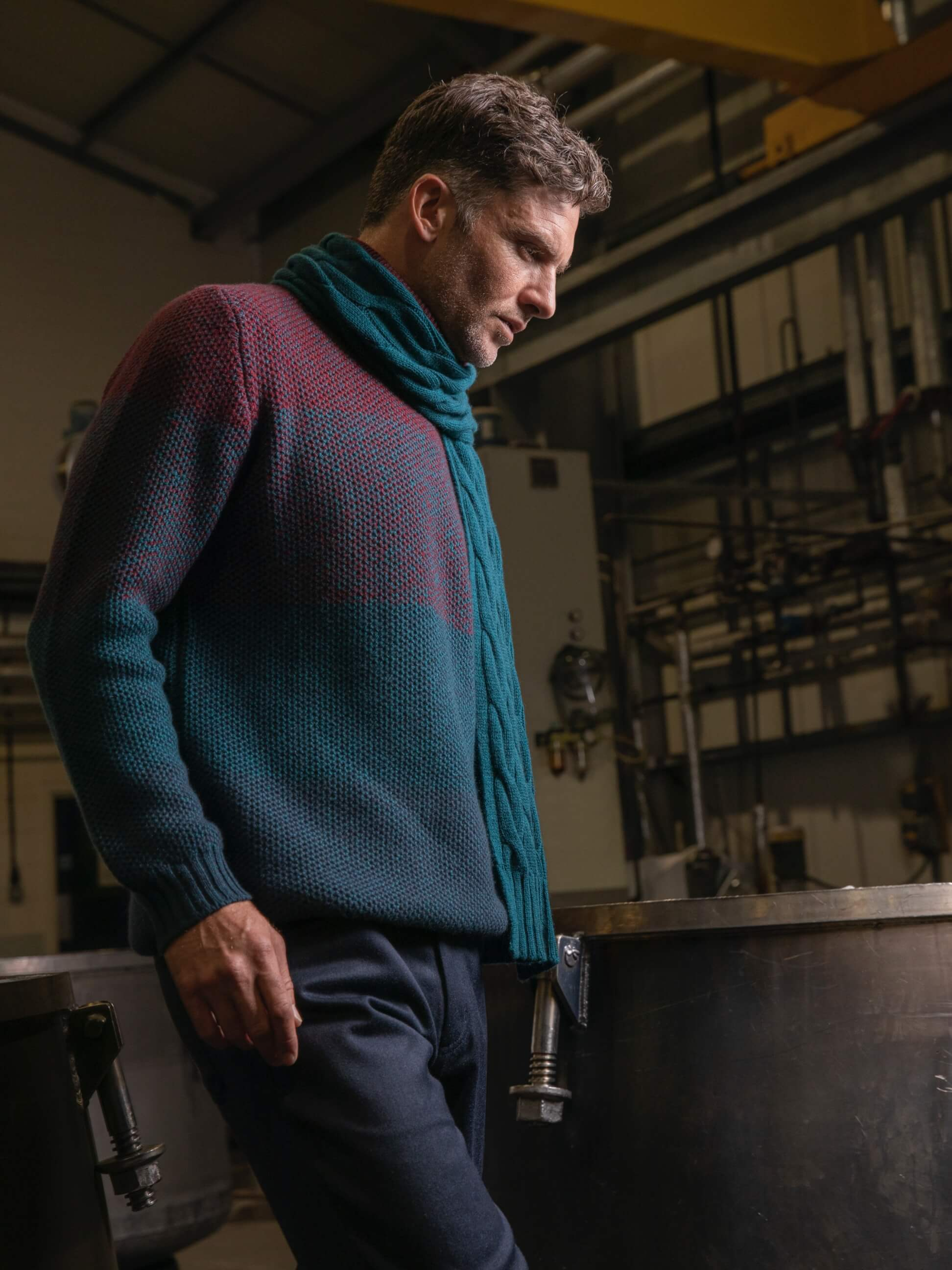 Johnstons of Elgin model wearing ombre cashmere in the Johnstons of Elgin dyehouse