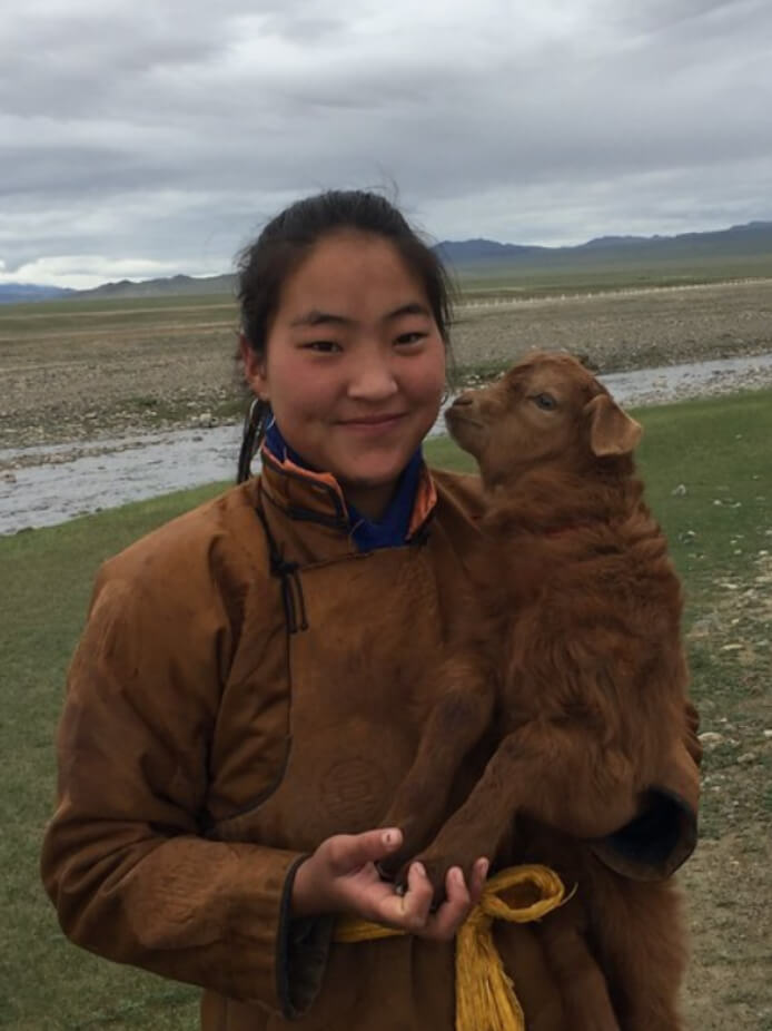 Herder with cashmere goat