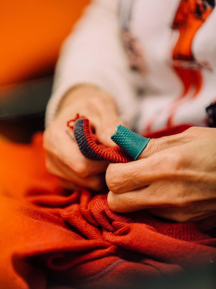 Stitching the neck of a jumper