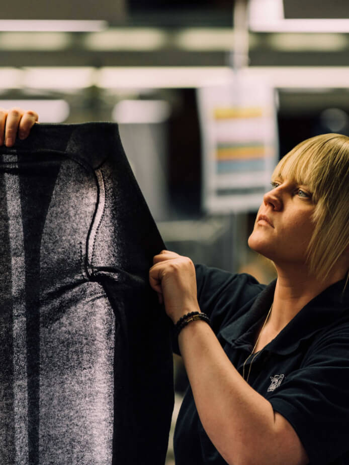 A Johnstons of Elgin piece being inspected