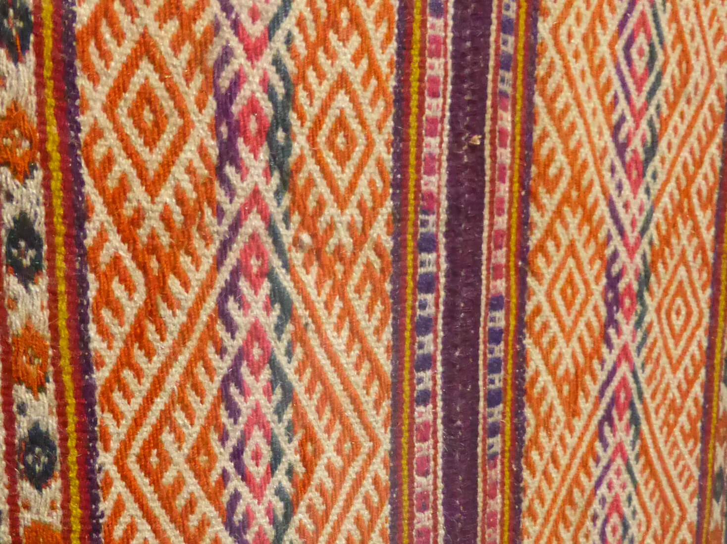 A colourful example of traditional weaving from Southern Peru. Each of the colours and motifs within the design have their own meaning in local folklore.