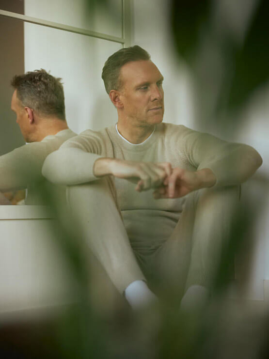 Joe Ottaway in Thomas Seamless Cashmere Joggers and Thomas Integral Shoulder Cashmere Sweatshirt in Natural