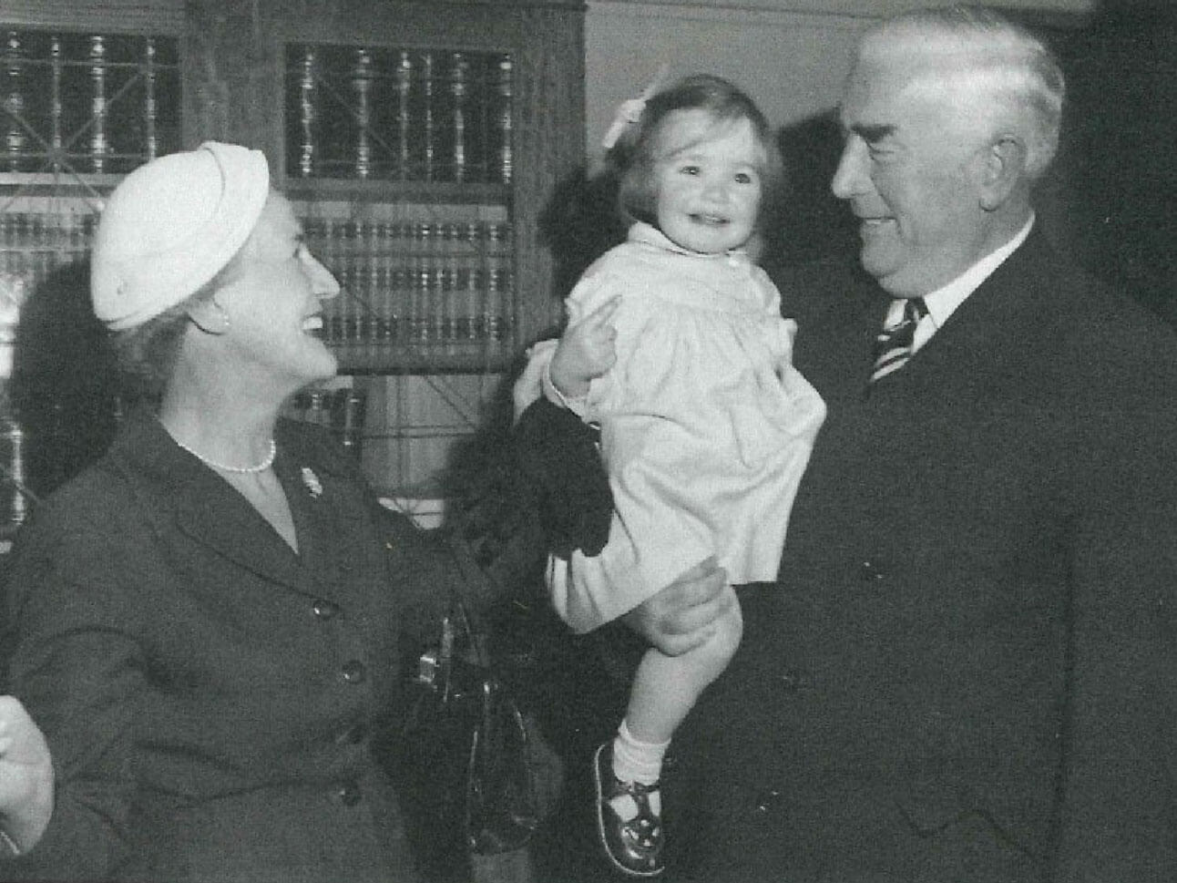 Dame Pattie and Sir Robert with their granddaughter Edwina who returned the scarf to Johnstons
