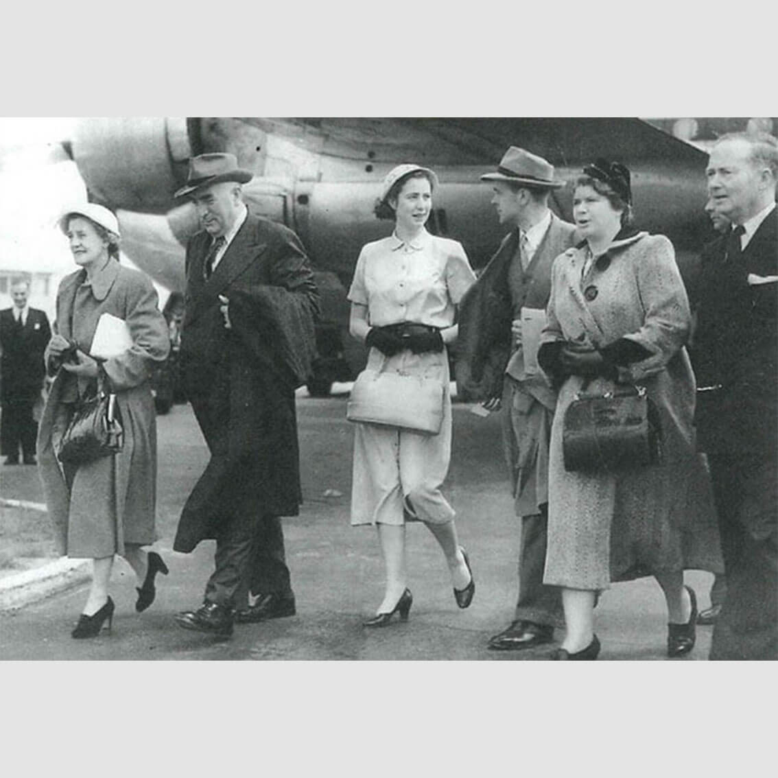 Dame Pattie and Sir Robert (far left) arriving at London Airport for the Queen's coronation with their daughter Helen (centre)