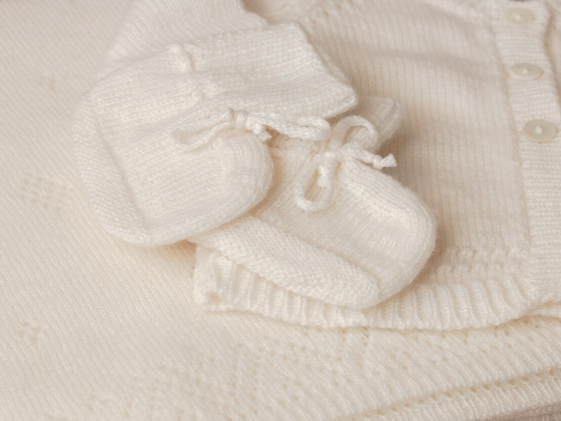 Gauzy Cashmere Baby Blanket with Pointelle Details, Hand Knitted Cashmere Baby Cardigan and Hand Knitted Cashmere Baby Booties in White