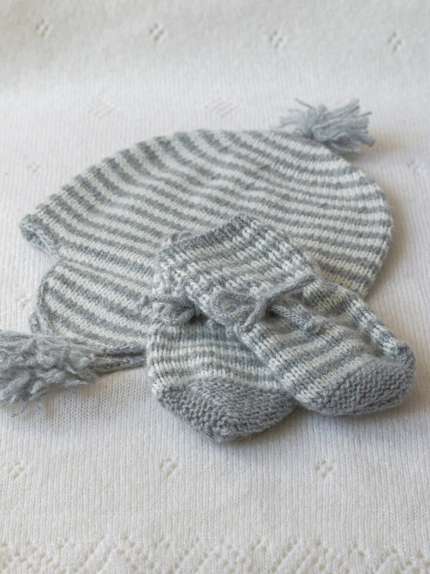 Cashmere Baby Hat with Hand Crotcheted Details and Hand Knitted Cashmere Baby Mittens in Silver Stripe